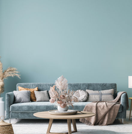 Soft blue living room sofa and wall painted to match