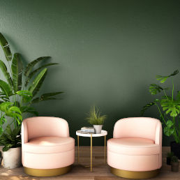 commercial space painted dark green with modern pink chairs